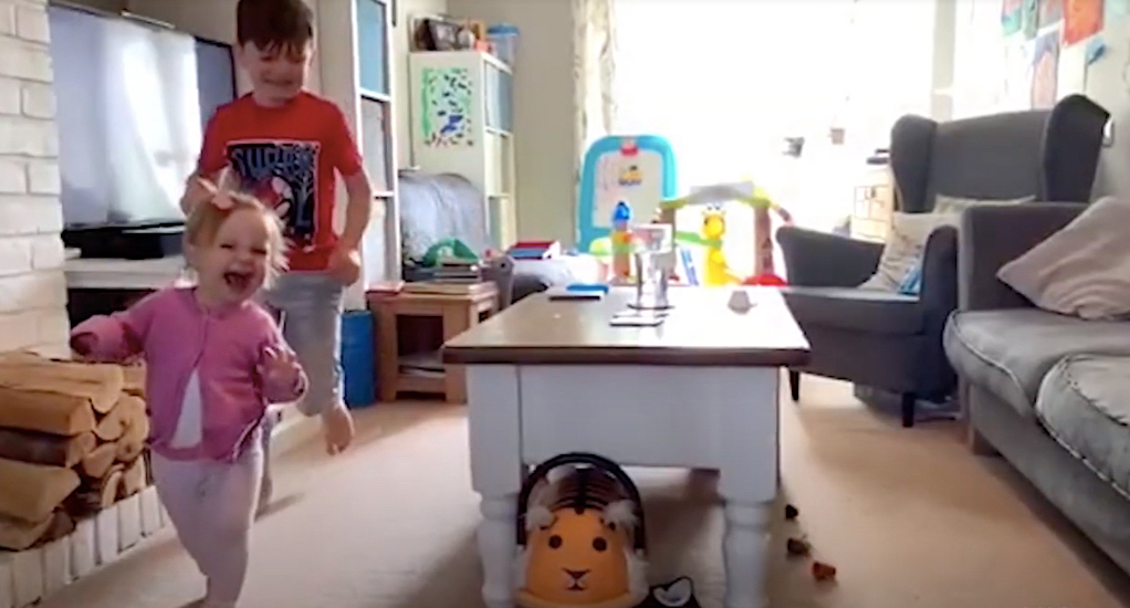 A child that is standing in a room Description automatically generated